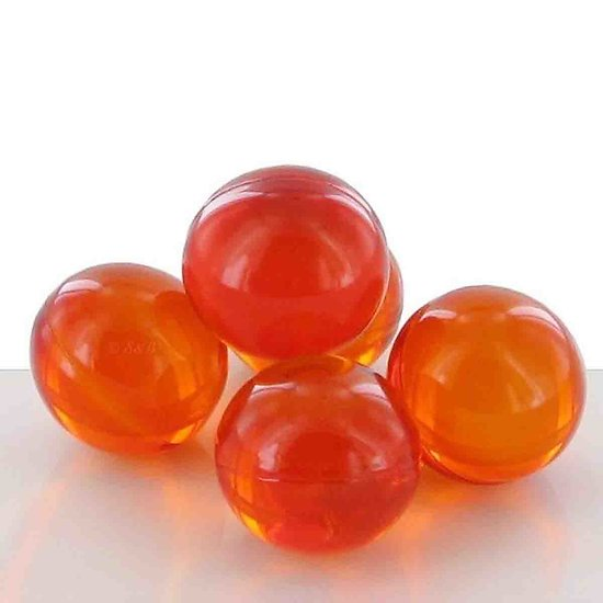 Perle de bain parfumée Abricot ronde en orange translucide