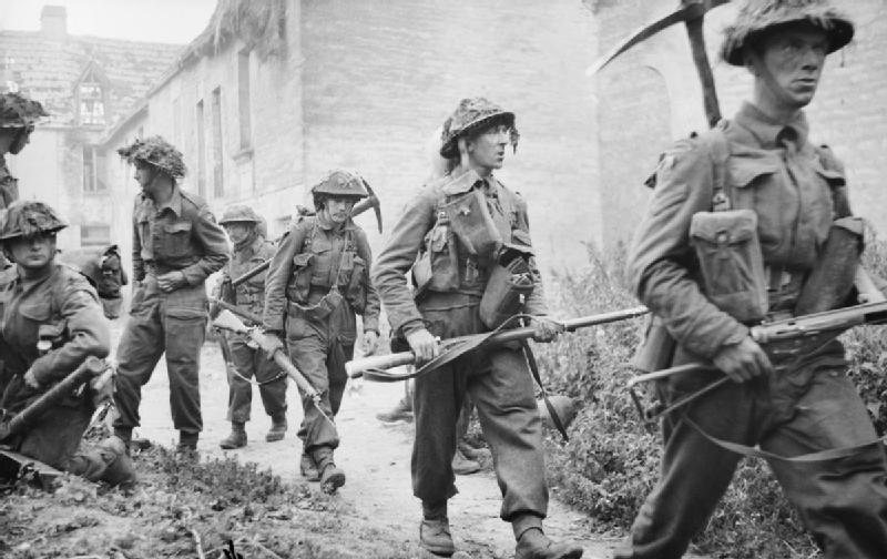 Infantry_of_6th_Royal_Scots_Fusiliers_15th_Scottish_Division_in_the_village_of_St_Mauvieu-Norrey_in_Normandy_during_Operation_Epsom_26_June_1944._B5968.jpg