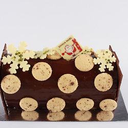 Bûche au chocolat et mignardises sucrées de Noël