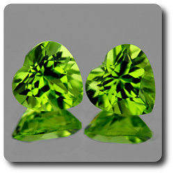 1.68 cts LOT DE 2 PERIDOT VERT . 6 MM . IF-VVS1 Pakistan