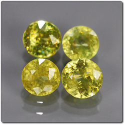 1.41 cts LOT DE 4 SPHENE MULTICOLORE. SI1-I1 Madagascar