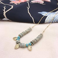 Vincianne - Collier perles plates // Doré
