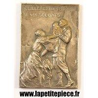Médaille Belge vendue au profils de l'habillement des enfants des soldats Belges.