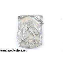 Vide poche en aluminium, cupidon et une cigogne.