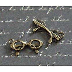 2 breloques lunettes en métal couleur bronze 22x16mm