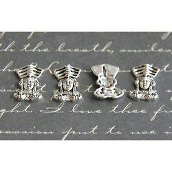 4 appliques empereur maya en métal argenté 9x13mm