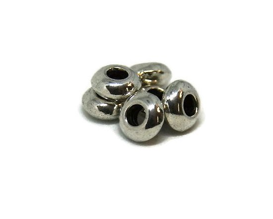 10 perles rondelles en métal argenté 8x4mm