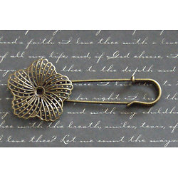 Broche à large estampe fleur en métal couleur bronze 35x83mm