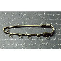 Grande broche 5 anneaux en métal couleur bronze 2x7cm