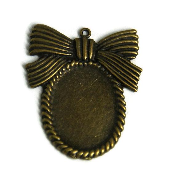 Support de pendentif noeud pour cabochon ovale en métal couleur bronze 46x39mm