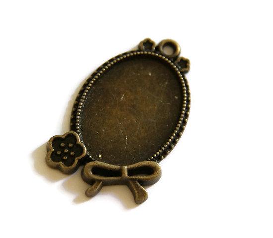 Support de pendentif pour cabochon ovale en métal couleur bronze 37x22mm