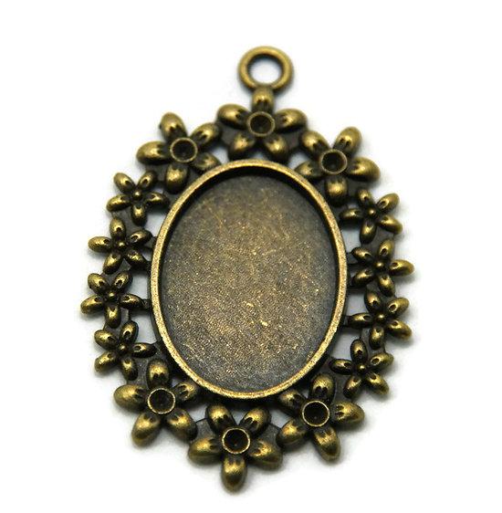 Support de pendentif pour cabochon ovale en métal couleur bronze 50x33mm