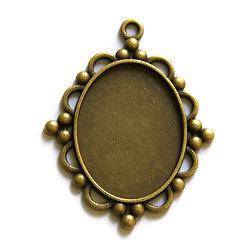 Grand support de pendentif pour cabochon ovale en métal couleur bronze 30x40mm