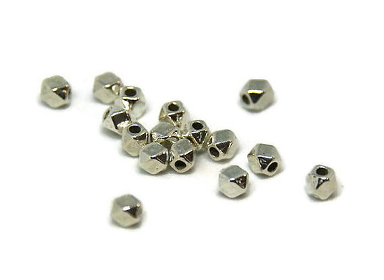10 petites perles hexagonales en métal argenté 3mm