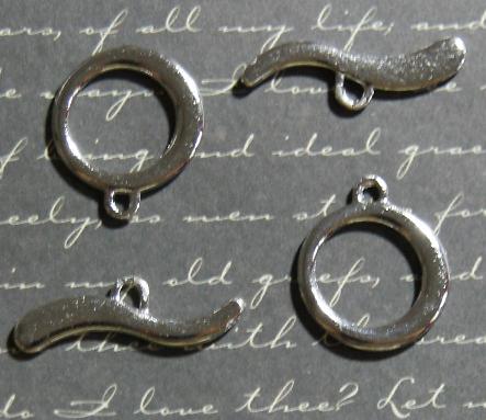 2 fermoirs toggle vague en métal argenté 9x28mm