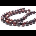 5 perles rondes et lisses oeil de taureau rouge/brun 8mm