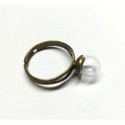 Support de bague en métal couleur bronze et son mini dôme en verre