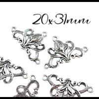 2 connecteurs arabesques en métal argenté 31x20mm