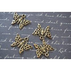 4 breloques papillons ajourées en métal couleur bronze 19x17mm