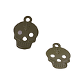 Breloque tête de mort ajourée en métal peint 17x12mm